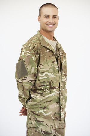 Studio Portrait Of Soldier Wearing Uniform