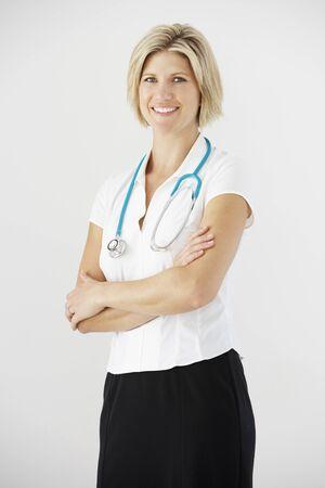 doctor female: Studio Portrait Of Female Doctor Against White Background