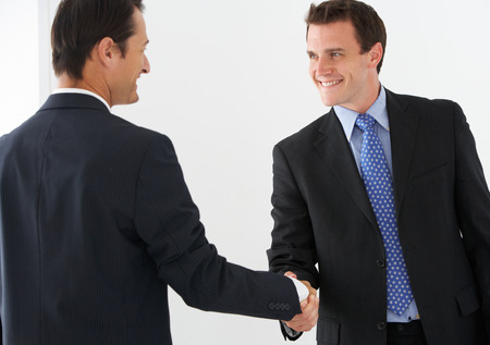 joyful businessman: Two Businessmen Shaking Hands