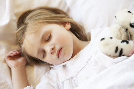 soft toy: Young Girl Sleeping In Bed With Soft Toy