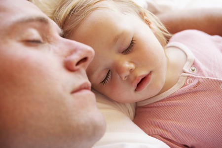 sleep man: Father And Daughter Sleeping In Bed