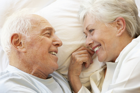 couple relaxing: Senior Couple Relaxing In Bed