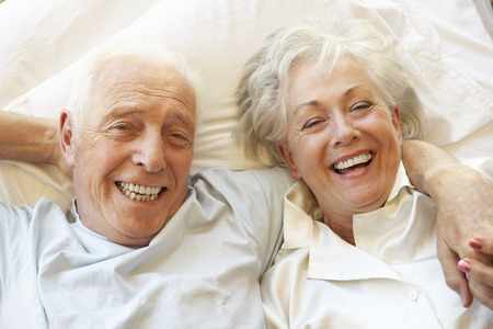 80s adult: Senior Couple Relaxing In Bed