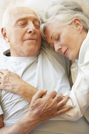 80s adult: Senior Couple Sleeping In Bed