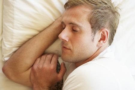 sleep: Man Sleeping In Bed Stock Photo
