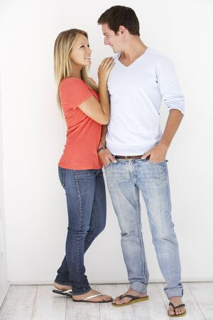 couples hug: Studio Portrait Of Romantic Young Couple Embracing Against White Background