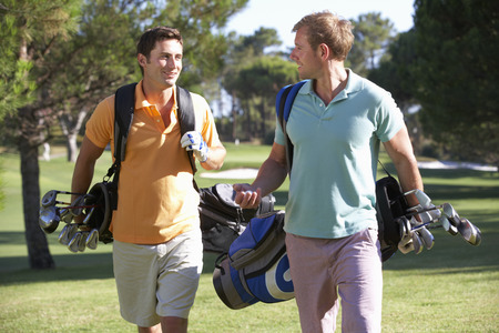 golf bag: Two Men Enjoying Game Of Golf