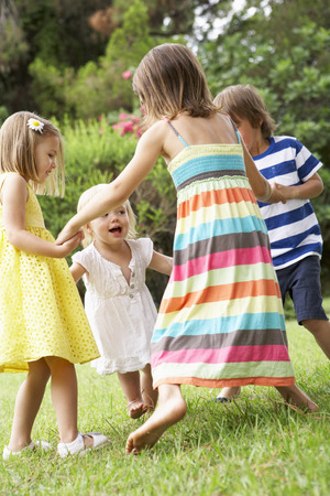16 year old: Group Of Children Playing Outdoors Together Stock Photo