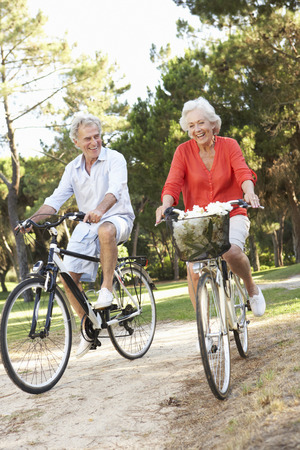 Exercising: Senior Couple Enjoying Cycle Ride Stock Photo
