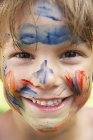 dirty blond: Head And Shoulders Portrait Of Boy With Painted Face Stock Photo