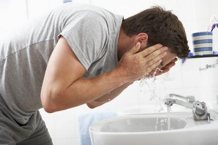 washing face: Man Washing Face In Bathroom Sink