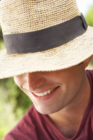 sun hat: Head And Shoulders Portrait Of Smiling Man With Sun Hat