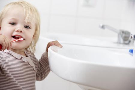 washbasin: Girl In Bathroom Brushing Teeth