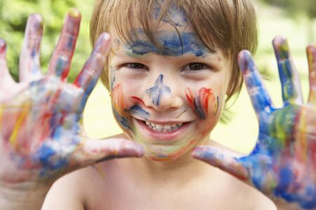 dirty blond: Head And Shoulders Portrait Of Boy With Painted Face and Hands