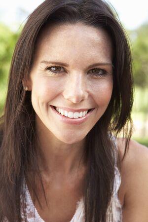 head shoulders: Head And Shoulders Portrait Of Smiling Woman