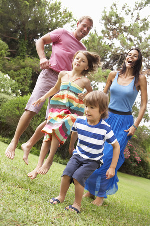 family playing: Family Playing In CountrysideTogether Stock Photo