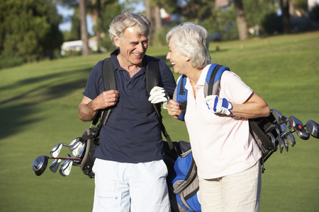 senior men: Senior Couple Enjoying Game Of Golf