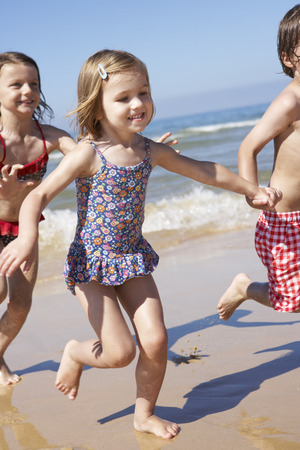 3 year old boy: Children Running Along Beach