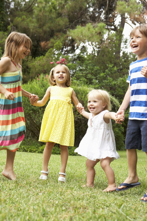 boy 16 year old: Group Of Children Playing Outdoors Together Stock Photo