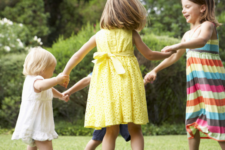 3 year old boy: Group Of Children Playing Outdoors Together Stock Photo