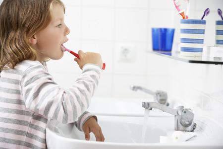 brushing teeth: Girl In Bathroom Brushing Teeth