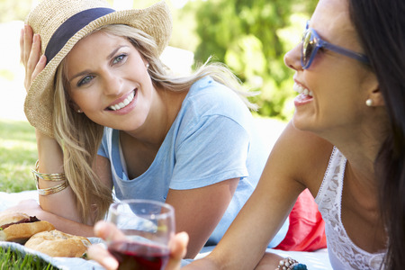Two Female Friends Enjoying Picnic Together