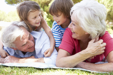 grandpa and grandma: Grandparents And Grandchildren In Park Together Stock Photo