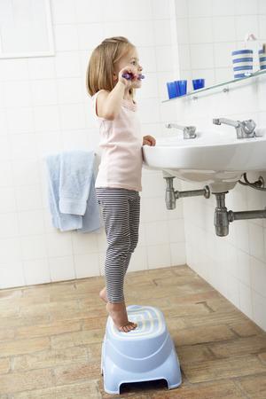 Girl In Bathroom Brushing Teeth