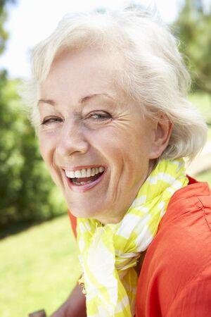 head shoulders: Head And Shoulders Portrait Of Smiling Senior Woman