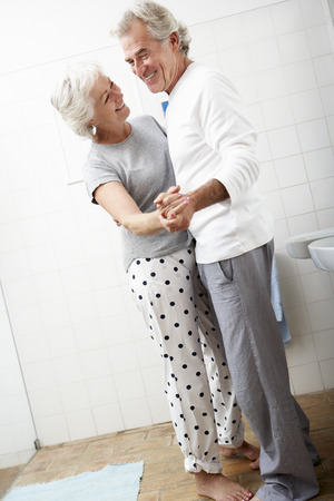 couple bathroom: Romantic Senior Couple In Bathroom Stock Photo
