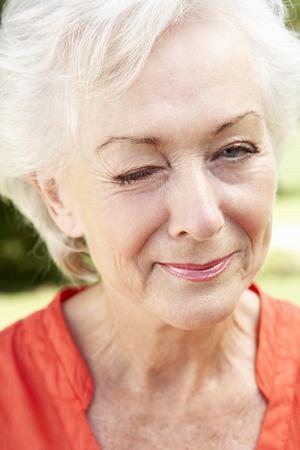 head shoulders: Head And Shoulders Portrait Of Winking Senior Woman Stock Photo