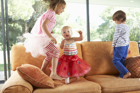 bouncing: Group Of Children Jumping On Sofa