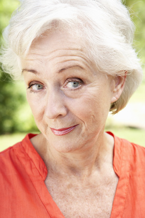 sceptical: Head And Shoulders Portrait Of Smiling Senior Woman