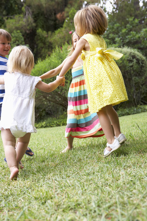 16 year old girls: Group Of Children Playing Outdoors Together Stock Photo