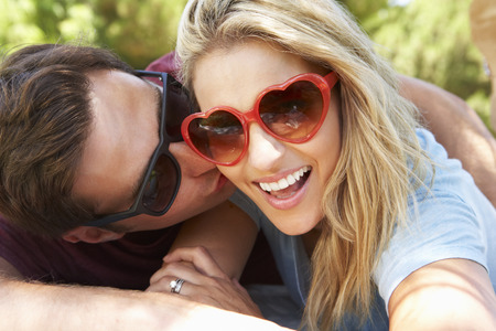 Romantic Couple In Park Together Stock Photo