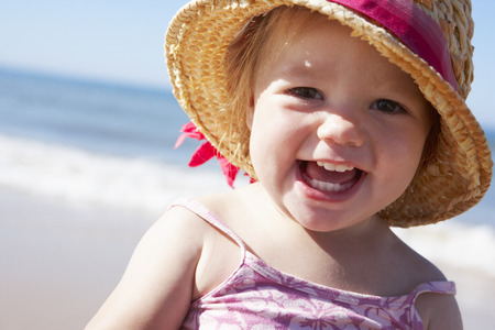 1 year old: Young Girl Playing On Sunny Beach