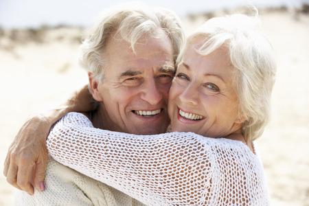 seniors walking: Senior Couple Walking Along Beach Together