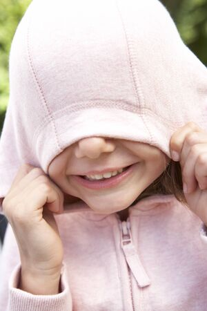 hooded top: Portrait Of Girl Hiding Face In Pink Hooded Top
