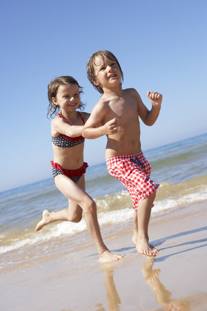 swimshorts: Children Running Along Beach