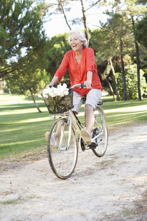 senior female: Senior Woman Enjoying Cycle Ride