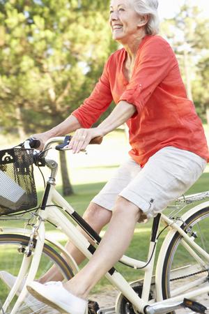 cycle ride: Senior Woman Enjoying Cycle Ride