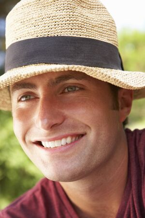 head shoulders: Head And Shoulders Portrait Of Smiling Man With Sun Hat