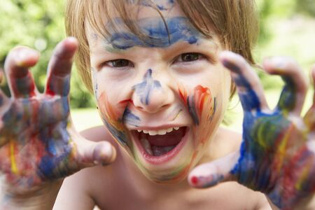 painted face: Portrait Of Boy With Painted Face and Hands Stock Photo