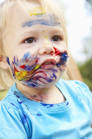 dirty blond: Head And Shoulders Portrait Of Girl With Painted Face