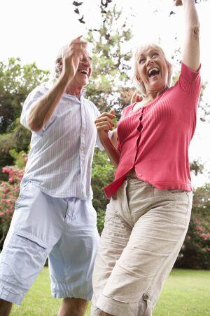 energetic: Energetic Senior Couple In Countryside Stock Photo