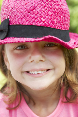 pink hat: Head And Shoulders Portrait Of Girl Wearing Pink Straw Hat Stock Photo