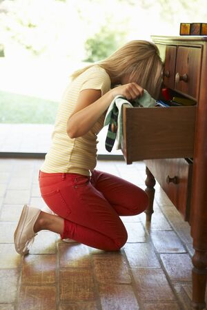 drawers: Woman Searching For Something In Drawers