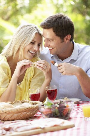 couple outdoor: Couple Enjoying Outdoor Meal Together
