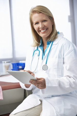one person: Female Doctor In Surgery Using Digital Tablet