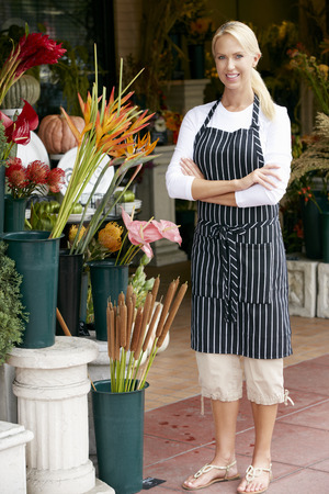 florist shop: Portrait Of Female Florist Outside Shop Stock Photo